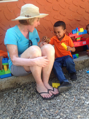Joan plays blocks with a Project Mañana student