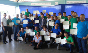 Graduating inmates with Guillermo Torres